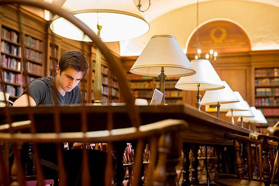 Renajd Rrapi '16 studies inside the Adams House library.