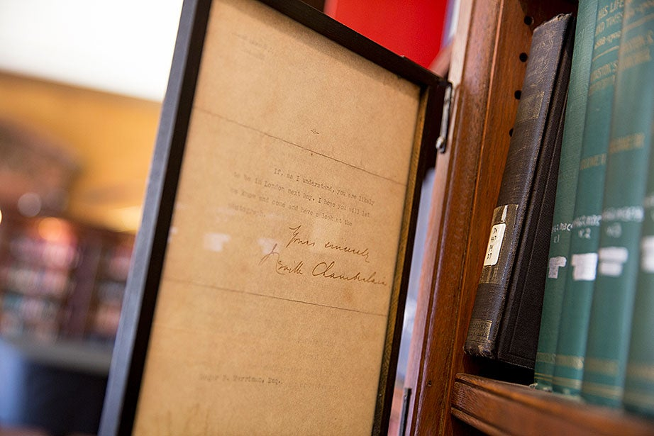 A letter signed by Neville Chamberlain is on display in the Eliot House library.