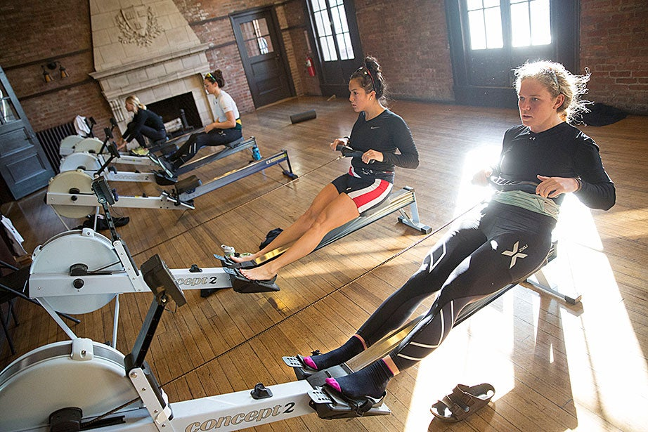 Radcliffe crew team members Mary Carmack '16 (front) and Emily Gaudiani '17 exercise on rowing machines.