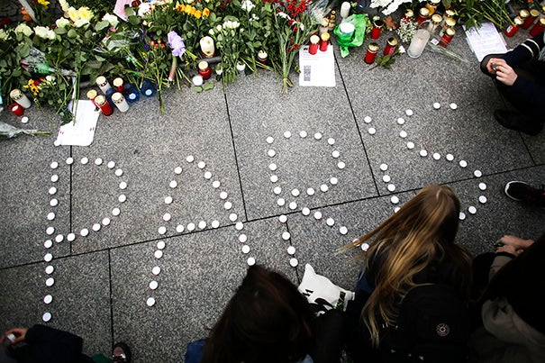 During a pair of interviews, Harvard Kennedy School analysts weighed in on the deadly and shocking terrorist attacks believed orchestrated by the Islamic State in Paris and Beirut. With the world still shocked by the violent attacks, young women formed  the word Paris with candles to mourn for the victims killed in  Friday's attacks in Paris.