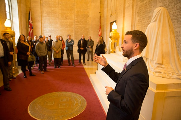 Harvard continuing education student and Army Specialist J. Holden Gibbons led 50 fellow veterans on a tour of Memorial Hall as part of the inaugural Official Harvard Military History Tour. Director of the Harvard Veterans Alumni Organization former Capt.