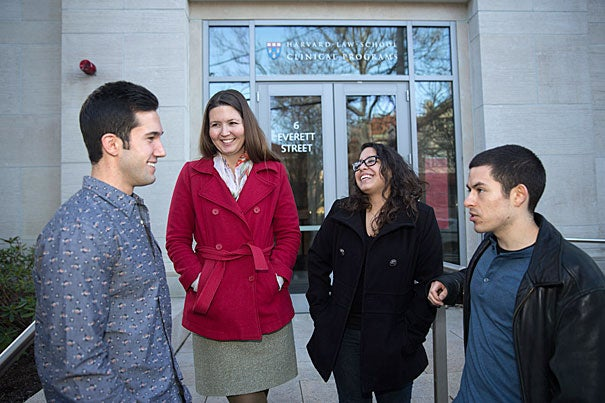 Amanda Kool (red jacket) directs the Community Enterprise Project at Harvard Law School, where students like Matthew Diaz (from left), Carolyn Ruiz, and Steven Salcedo help small business owners, entrepreneurs, and community groups.