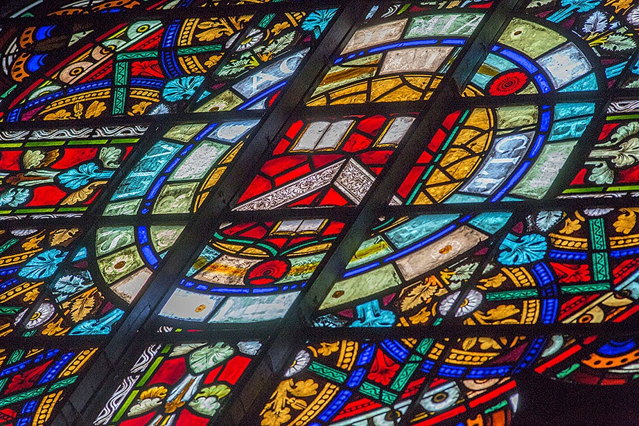 """A detail of Donald MacDonald's """"The West Window"""" (1874) shows a veritas symbol in the center."""
