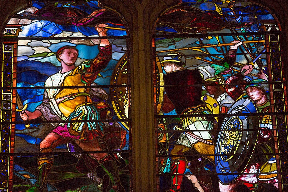 Artist John La Farge created this window of a classical warrior clad in a light-colored cuirass, striding toward the viewer's left with his body and head turned back to encourage his followers in 1881.