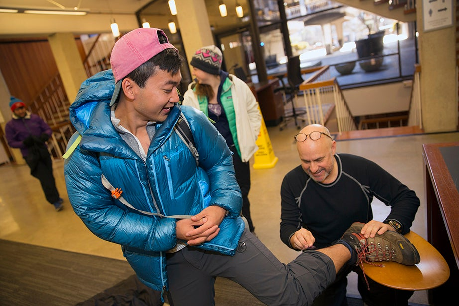 Harvard Business School student Michael Zheng '12 is worked on by teacher Jeff Toorish during a simulated emergency. Kris Snibbe/Harvard Staff Photographer