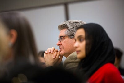 """""""We're preparing the leaders in international development and teaching them how to change the world,"""" said Fernando Reimers (center), director of the Global Education Innovation Initiative and the International Education Policy Program."""