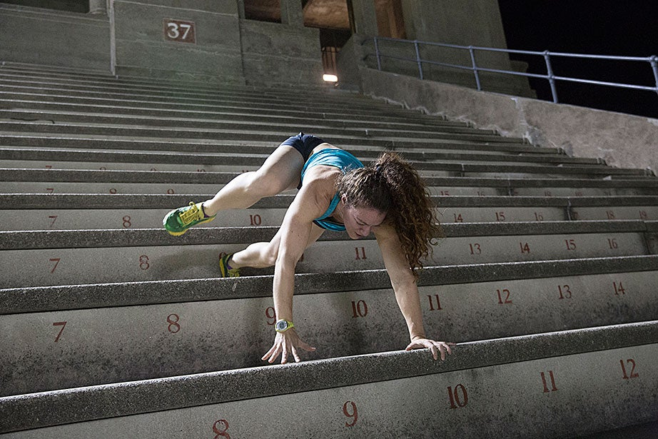Not to be outdone by Steve Zolud's downward bear crawl, Emily Saul, a trainer with the November Project, demonstrates a bear crawl up the steps, and backwards. Very few step climbers perform this routine, with good reason: It is extremely difficult and exhausting.