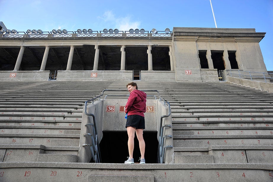 """Sue Parker, head coach of the Harvard women's rugby team, takes a last look back at the steps after completing a circuit of all 37 sections. """"This stadium is so beautiful,"""" she says. """"It's almost like these steps are asking to be run. If you do them, you can just feel satisfied the whole rest of your day."""""""