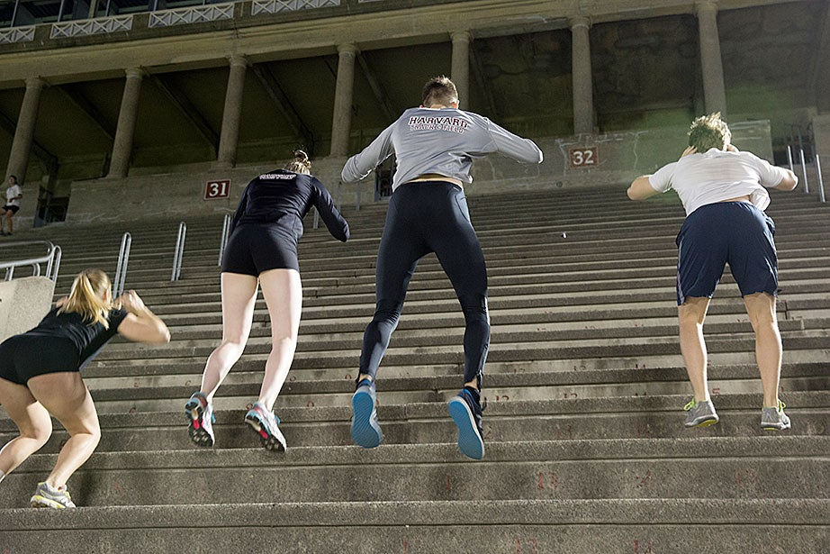 """Harvard Track and Field team members do a standing two-legged hop up the seats. Their routine involved hopping up about a dozen seats, resting briefly, then doing another nine or 10 sets —and that was the restricted, """"lighter"""" workout."""
