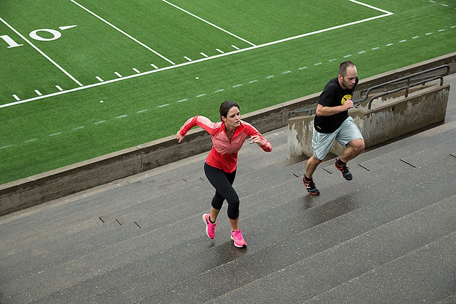 """Christiana White, a fourth-year joint degree student doing her M.D./M.B.A. at Harvard Medical School and Harvard Business School, runs the Stadium steps with her friend Jeff Judkins, HBS '17. """"This was my first time on the steps! It was great! Exercise helps me with anxiety and is a big stress release. It's definitely challenging, but when I do this I'm just happier!"""" White said. Three weeks after this photo was taken, White ran her first marathon and fulfilled her goal of qualifying for next April's Boston race."""