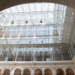 The new glass rooftop that now tops Harvard Art Museums allows natural light to filter down into the courtyard.