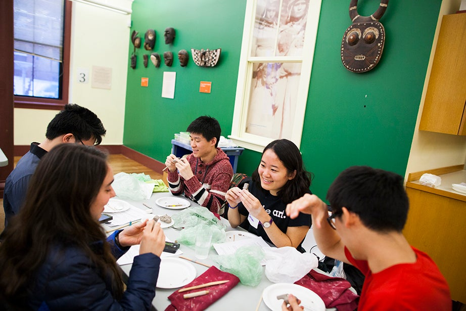 A clay flute workshop was one course offered as part of Wintersession. In the Peabody Museum, ceramicist Kathi Tighe teaches Marisa Houlahan '17 (clockwise from left), Jerry Anunrojwong '18, Fred Lu '16, Sarah Yeoh-Wang '17, and Ryan Song '17. Stephanie Mitchell/Harvard Staff Photographer
