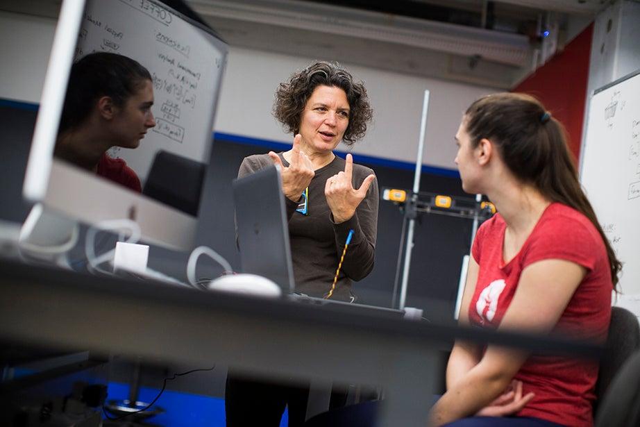 Kim Bernard (left) and Elaine Reichert '18 explore the class assignment. Stephanie Mitchell/Harvard Staff Photographer