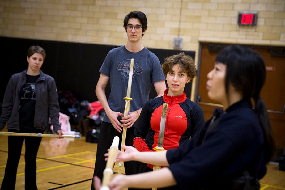 Rebecca Chen '16 (right) teaches Kendo as, from left, Yasmin Yacoby '19, Samuel Vasquez '18, and Anisa Kureishi '19 watch. Rose Lincoln/Harvard Staff Photographer