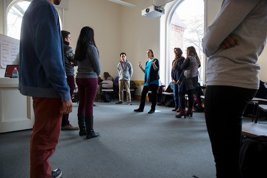 Leadership and development coach Margie Zohn (center) leads an exercise in public speaking in Boylston Hall, where students share stories with the group. Rose Lincoln/Harvard Staff Photographer