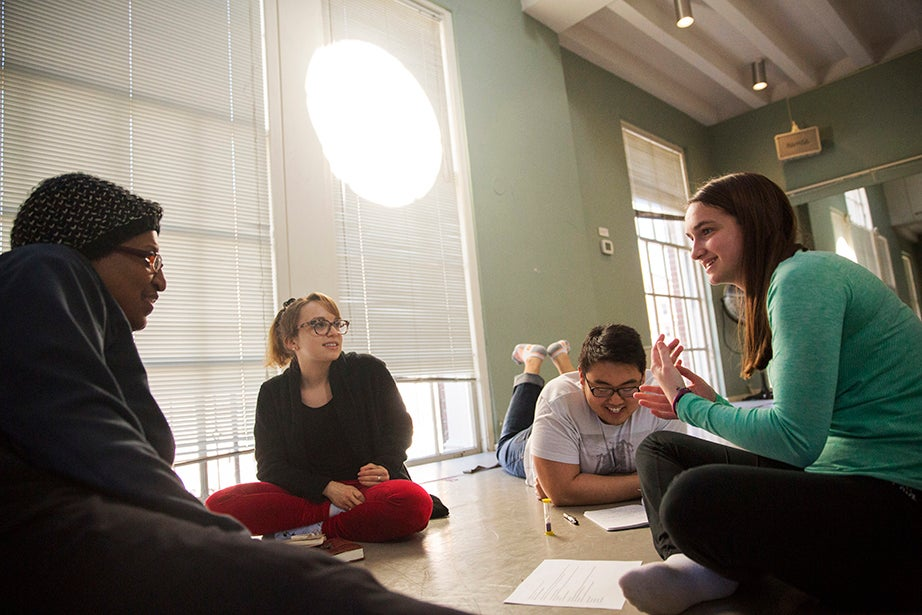 """Patricia Courtney of Harvard Extension School (from left), Olivia Munk '16, KeeHup Yong '19, and Grace Ramsey '19 work together during """"Performing Our Experience: Tools for Creating Original Theater"""" inside the Director's Studio at the Office for the Arts. Kris Snibbe/Harvard Staff Photographer"""