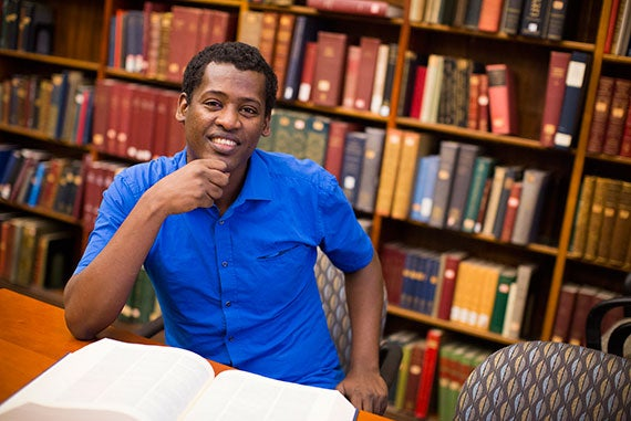 Scholars at Risk Fellow Beekan Guluma Erena is an Oromo writer and scholar who has taught Afaan Oromo and Oromo Literature and has published works on political, social, and economic issues facing the Oromo in Ethiopia. He is pictured in Widener Library at Harvard University. Stephanie Mitchell/Harvard Staff Photographer