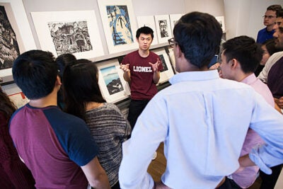 "A group of students from ""The Art of Looking"" visited the Harvard Art Museums under the guidance of freshman Ted Zhu (center). Mostly science concentrators, the students were intent on deepening their understanding of how to look at art with a critical eye."