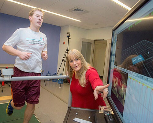 A new study led by Professor of Physical Medicine and Rehabilitation Irene Davis (right) found that a group of runners who had never been hurt landed each footfall more softly than a group who had been injured badly enough to seek medical attention. Pictured on the treadmill is Matthew Ruder, a laboratory engineer at  Spaulding National Running Center.
