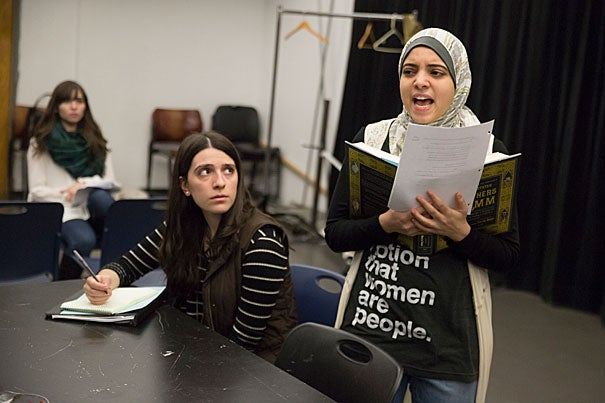 "Sammi Cannold (center), an artistic fellow at the American Repertory Theater, oversees a rehearsal of ""A Language to Hear Myself"" with Anwar Omeish '19 (right) and Caro Ribeiro '18 (left)."