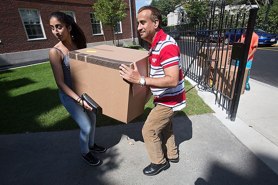 Kulbir Parmar (right) helps his daughter Shivangi Parmar '17 during move-in day at Dunster House. Jon Chase/Harvard Staff Photographer