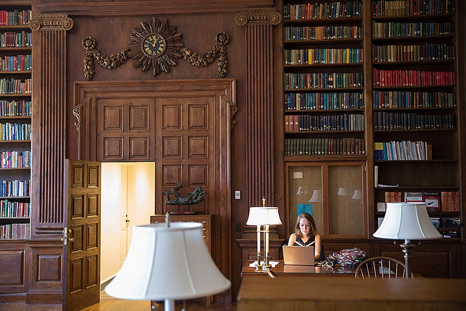 Elena Breer '18 enjoys the Harvard Library study room in the newly renovated Dunster House. Kris Snibbe/Harvard Staff Photographer