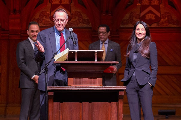 Dean William Fitzsimmons introduces actress and philanthropist Lucy Liu as the Harvard Foundation's 2016 Artist of the Year. Jonathan Sands '17 (left) and Harvard Foundation Director S. Allen Counter are pictured in the background.