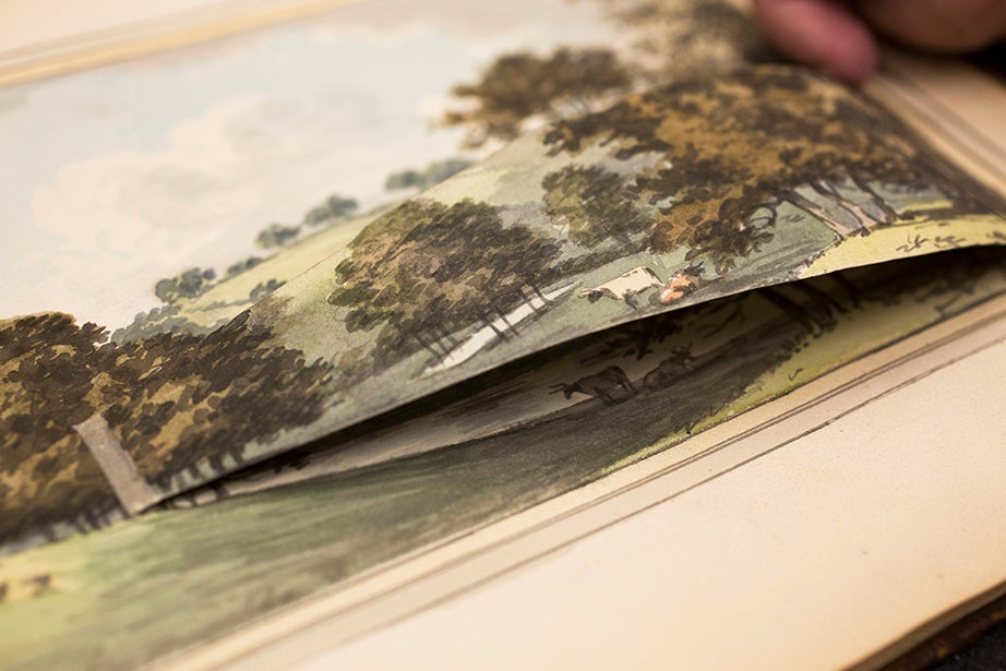 The book is actually a project bid for landscape architect Humphry Repton, who hand-illustrated the pages. The flap reveals the proposed changes for the grounds of an English estate.