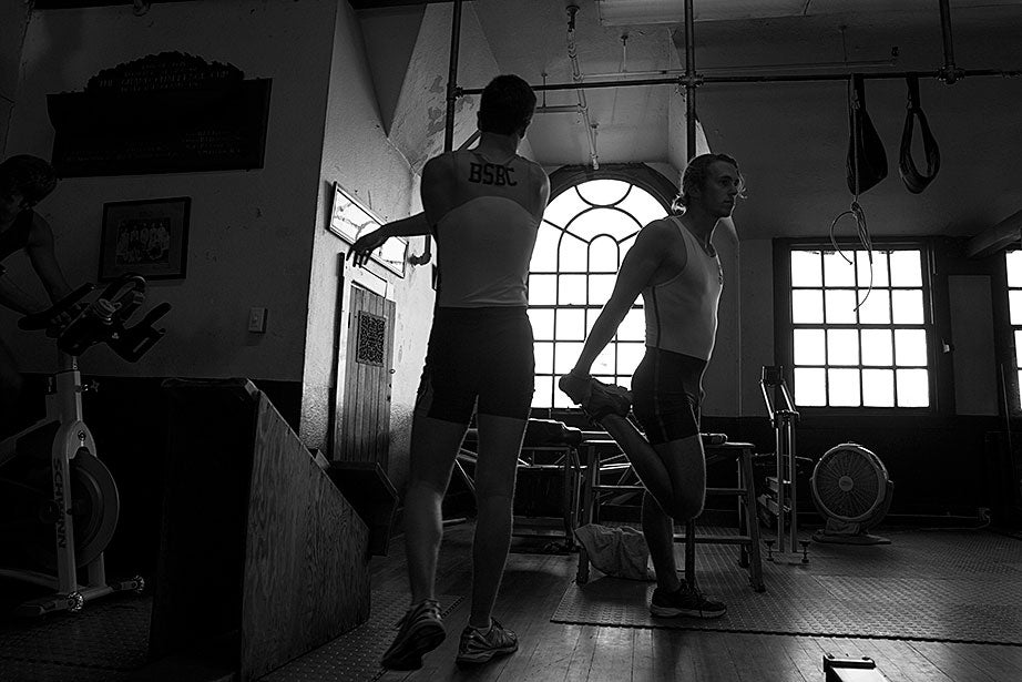 At Newell Boathouse, lightweight crewmen stretch their muscles before hitting the rowing machines.