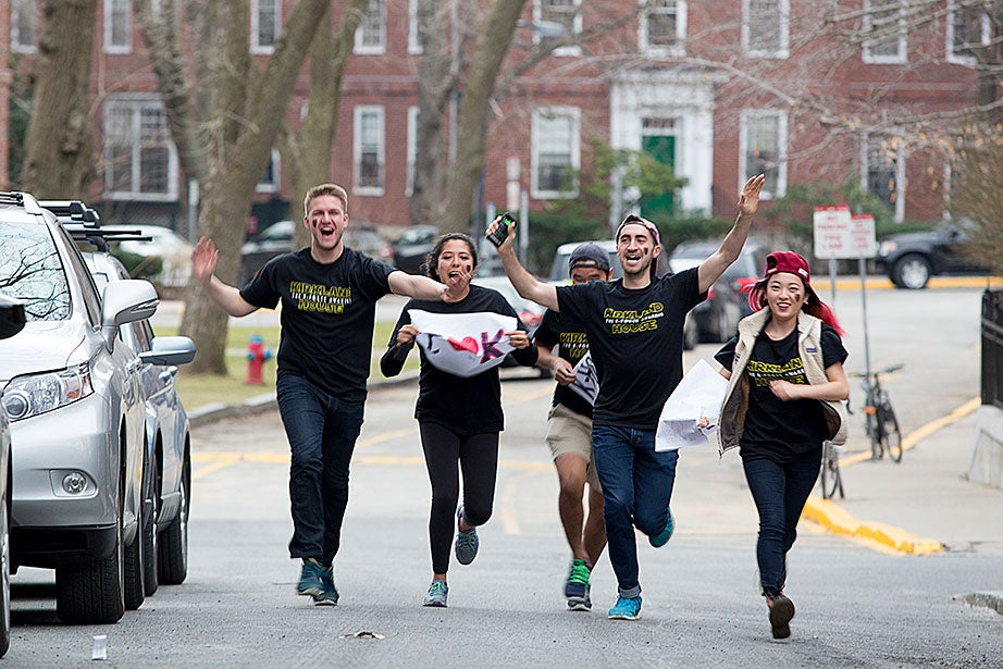 Kirkland House students run to catch up on Dunster Street. Rose Lincoln/Harvard Staff Photographer