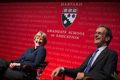 Harvard President Drew Faust and her brother, retired English and drama teacher Donald Gilpin, shared their thoughts on education at an Askwith Forum at the Harvard Graduate School of Education. Faust emphasized that education is about civic engagement, human engagement, and meaningful lives.