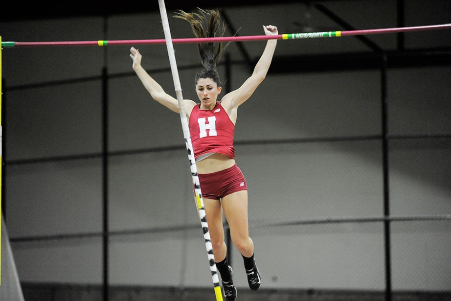 Marlee Sabatino '18 clears the bar in the pole vault. She cleared 12 feet 11.5 inches (3.95 meters) for a new school record.
