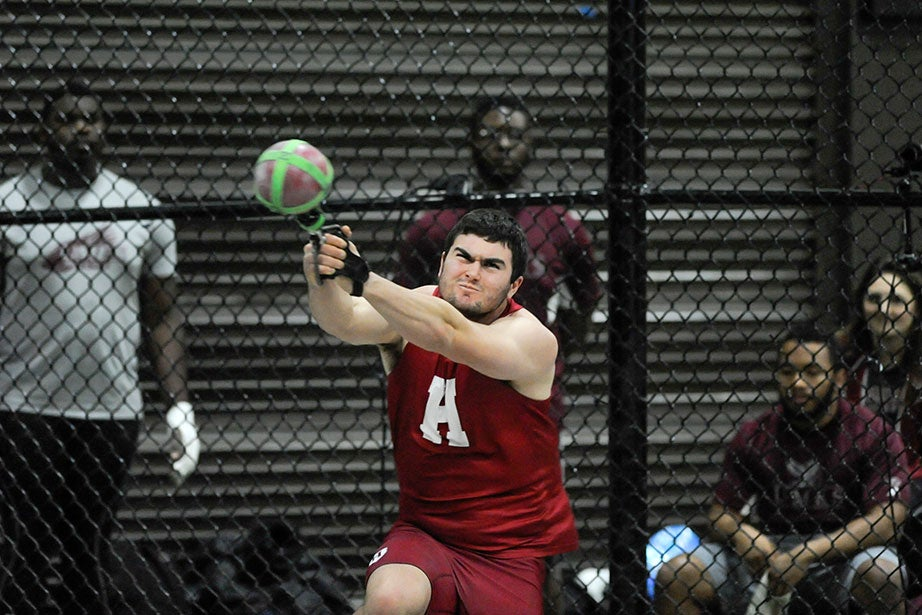 Josh Whitener '17 lets go a heave of 58 feet 3.75 inches (17.77 meters) in the weight throw, good for third place.