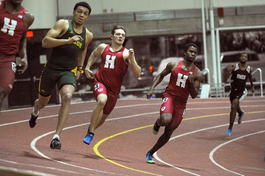 Garrett Rouser '19 (center) and Randy Raymond '18, far right, round the turn in the 400 meters. Rouser finished fifth in 50.74 seconds, while teammate Raymond was clocked at 51.35.