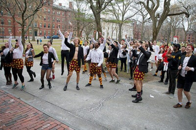 Adams House residents announce their presence to freshmen inside Holworthy Hall. Rose Lincoln/Harvard Staff Photographer