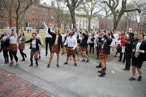 Adams House residents announce their presence to freshmen inside Holworthy Hall. Rose Lincoln/Harvard Staff Photographer