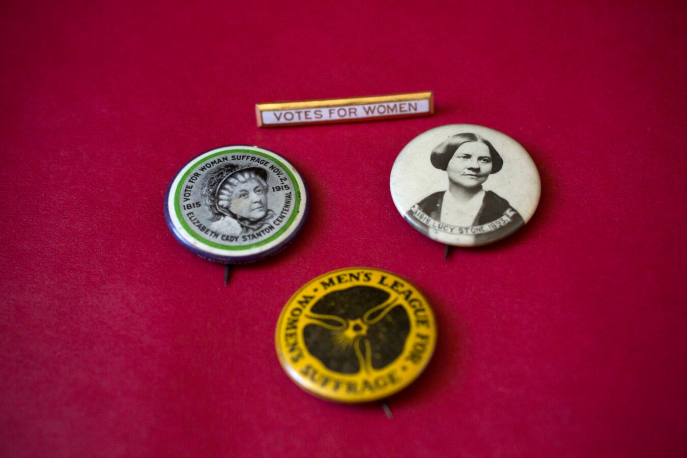 Women's suffrage buttons show the likenesses of early suffragists Elizabeth Cady Stanton and Lucy Stone.