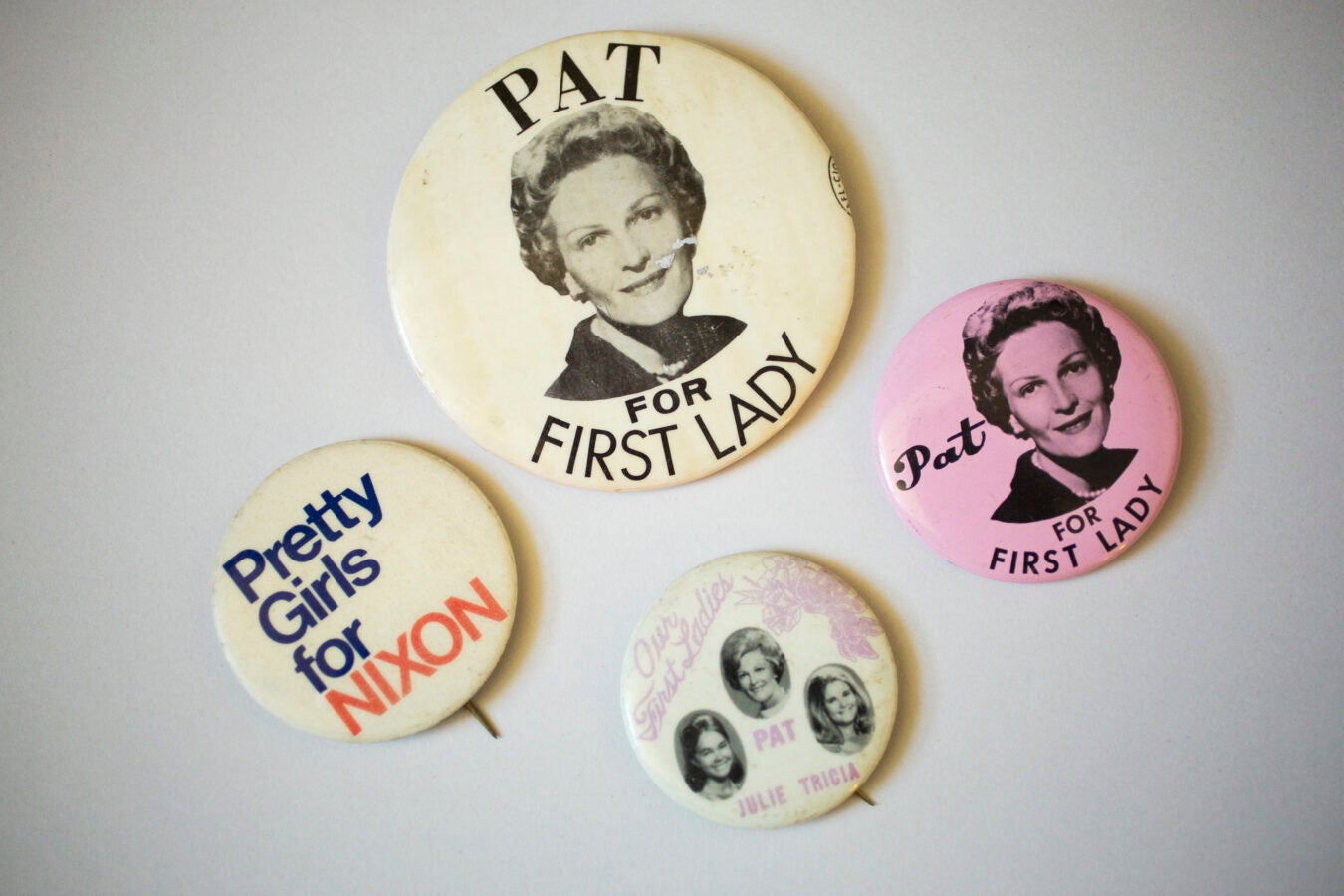 Pat, Julie, and Tricia Nixon had their own supporters and buttons.