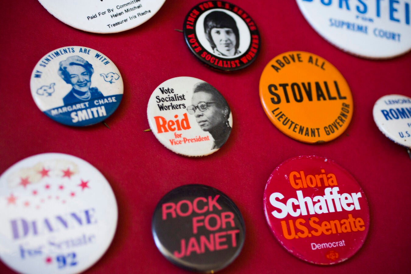 Buttons representing female candidates from conservative to socialist parties.