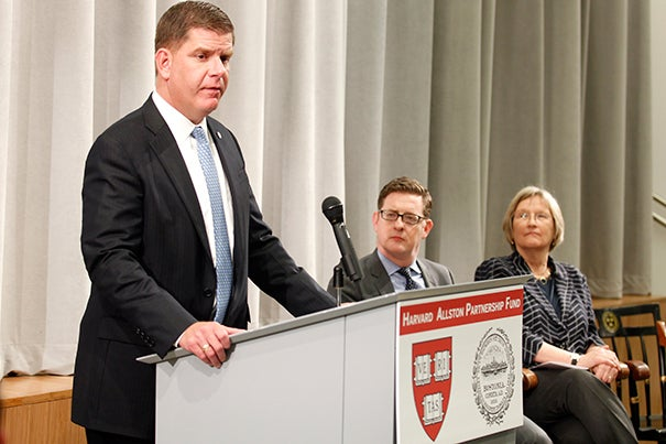 """""""The HarvardAllstonPartnership Fund is a key component of the well-being of our localAllston-Brighton community,"""" said Boston Mayor Martin J. Walsh (podium) during the announcement of the grants. Vice President for Harvard Public Affairs and Communications Paul Andrew and President Drew Faust were on hand to honor the grant recipients."""
