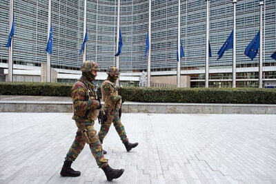 Following Tuesday's bombings, security forces patrol the area in front of the European Commission building in Brussels. Analysts said the attacks expose serious flaws in the effectiveness of the European Union's security and intelligence agencies.
