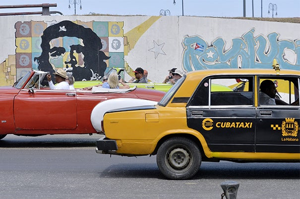 President Obama's visit to Cuba represents the culmination of his efforts to re-establish ties with the island nation, according to Harvard scholars.