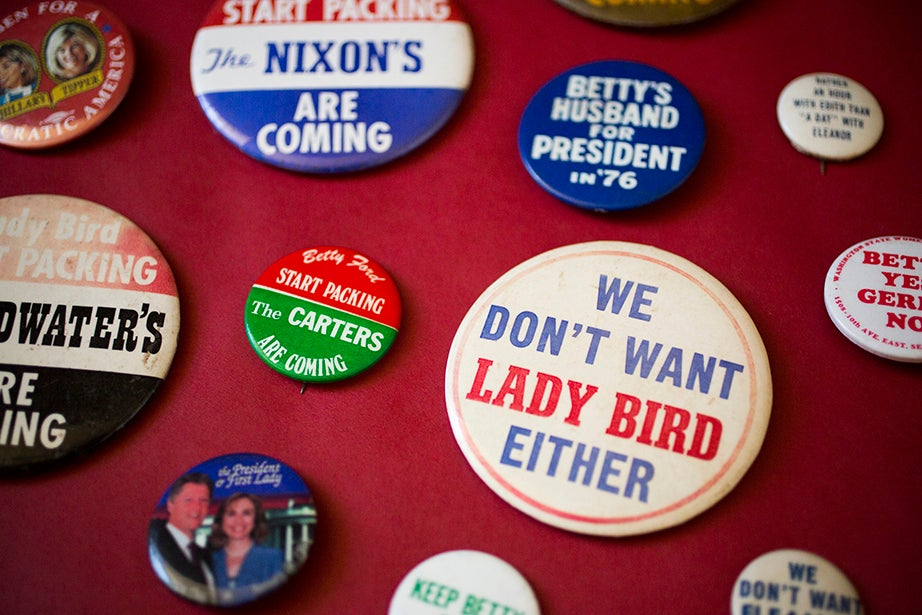 Campaign buttons are not just for the candidates but also for their spouses.