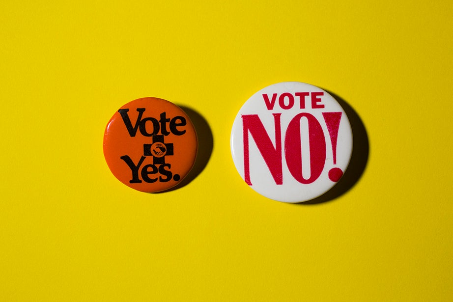 Buttons for and against ballot initiatives.