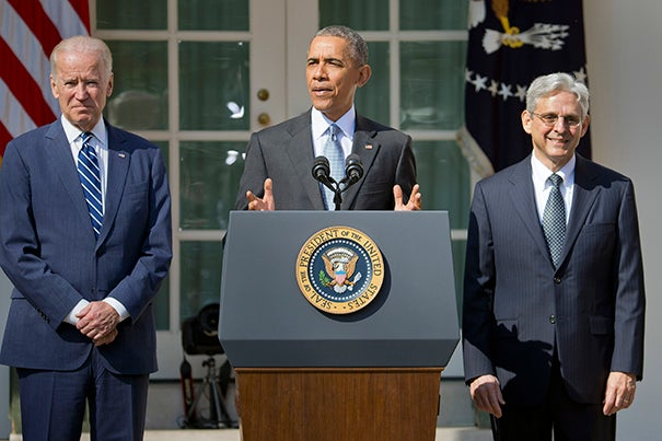 Federal appeals court judge Merrick Garland (right) stands in the Rose Garden of the White House with President Barack Obama and Vice President Joe Biden as he is introduced as Obama's nominee for the Supreme Court on Wednesday.
