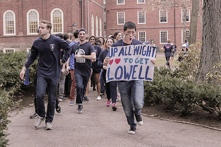 The newest residents of Lowell House cheer for their home in full spirit. Photo by Shraddha Gupta
