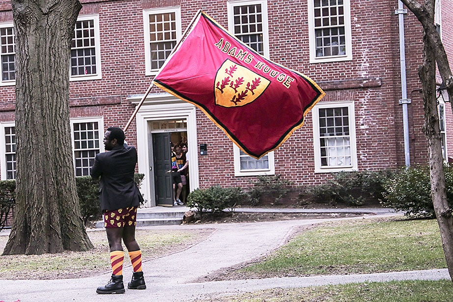 An Adams House resident proudly waves the House flag. Photo by Shraddha Gupta
