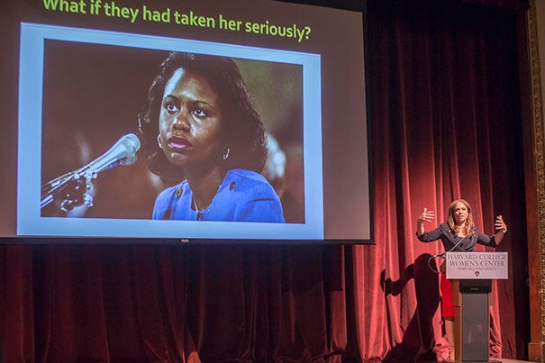 """The current knowledge economy limits women's work, leadership, and earning,"" Melissa Harris-Perry, a professor of politics and international affairs at Wake Forest University, told her Harvard audience at the fourth annual Anita Hill Lecture on Gender Justice. Hill, a professor at Brandeis University, is pictured on-screen."
