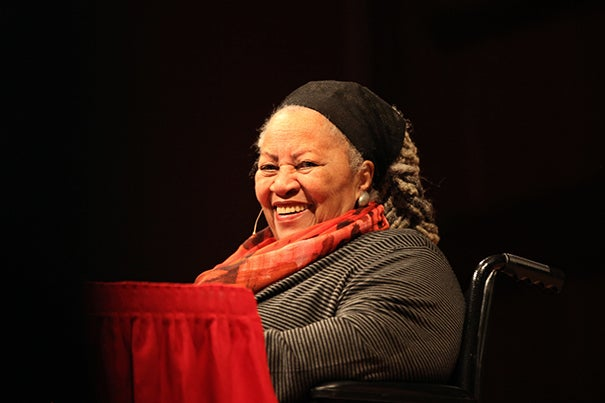 """Nobel Prize-winning Toni Morrison enjoyed a sustained standing ovation before beginning her first Charles Eliot Norton Lecture. Speaking from a wheelchair, she described her return to Harvard as """"comforting,"""" then launched into the human tendency """"to separate and judge those not in our pact."""""""