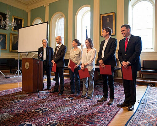 Doug Melton (from left) presented the Star Family Challenge awards to Edo Berger,  Katia Bertoldi, Talia Konkle, Bence Ölveczky, and Edward Glaeser. The grants are awarded annually to high-risk, high-reward research efforts that might not receive funding through other programs. Assistant Professor of Psychology Talia Konkle explained her research during the ceremony (photo 2).